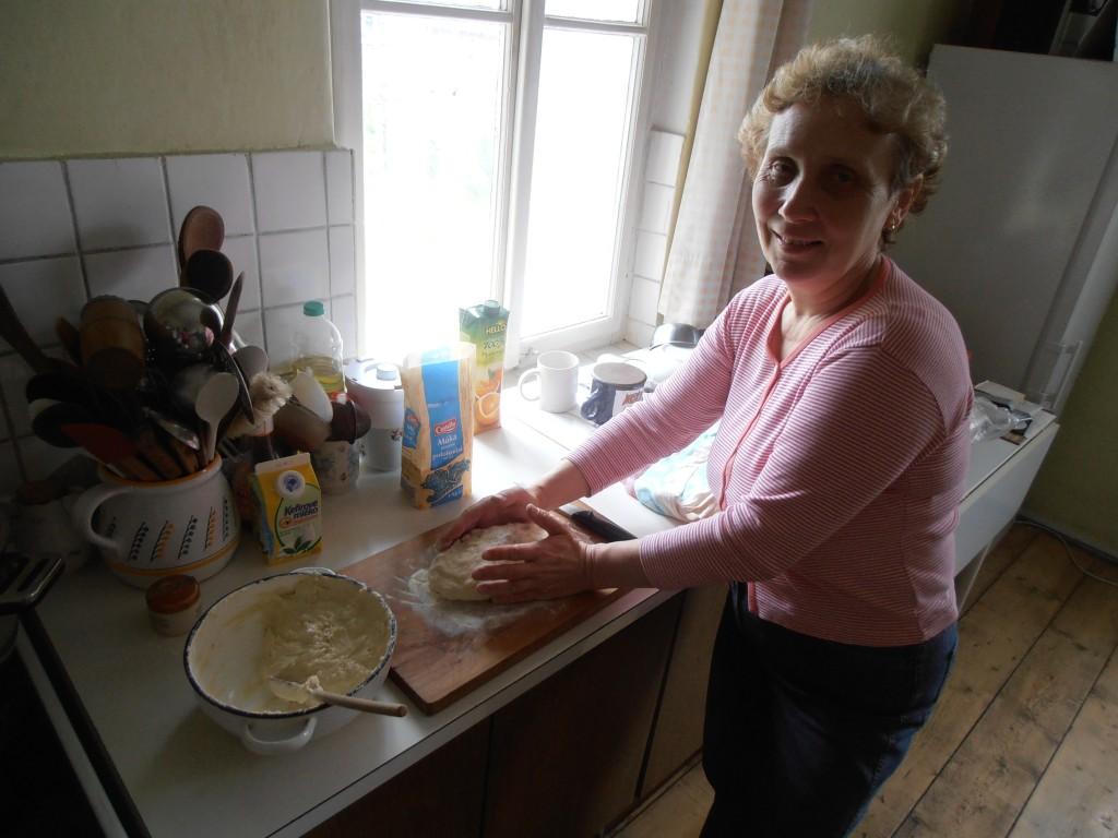 Alena rolling dumplings like a pro.  Czech dumplings are shaped like fat breadsticks, boiled, then served in slices like bread.